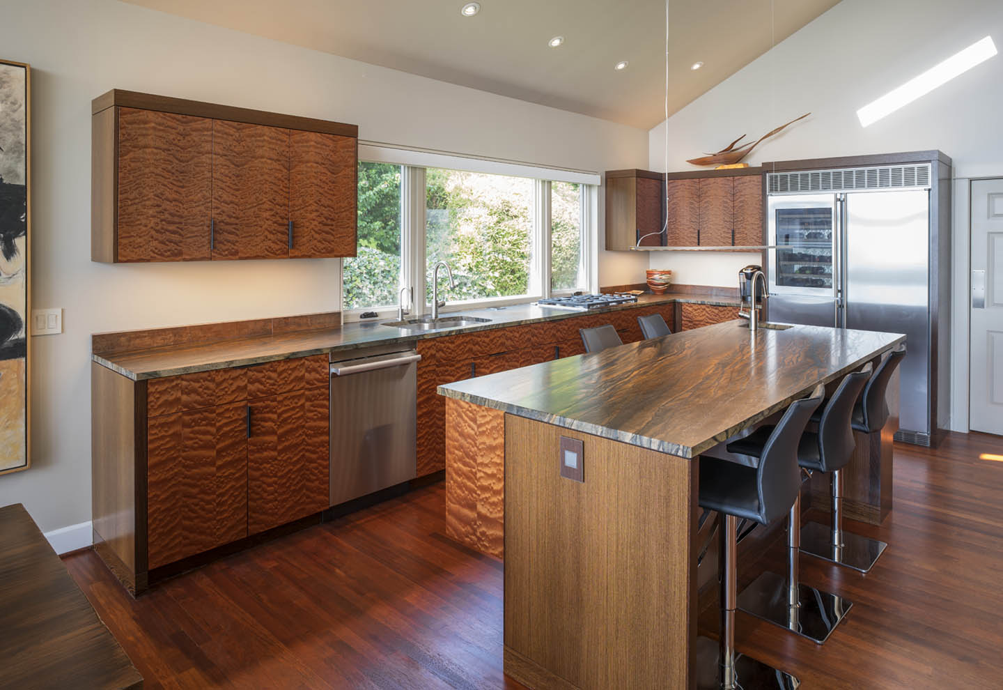 Bubbly and vibrant Quilted Makore and Wenge modern kitchen by Hugh Montgomery
