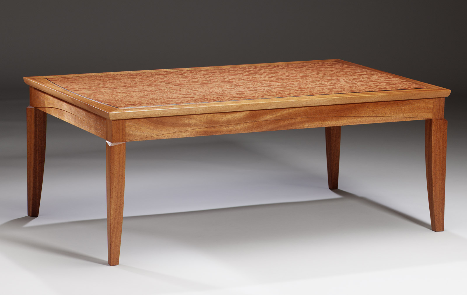 African Mahogany and mottled Makore wood coffee table by Hugh Montgomery