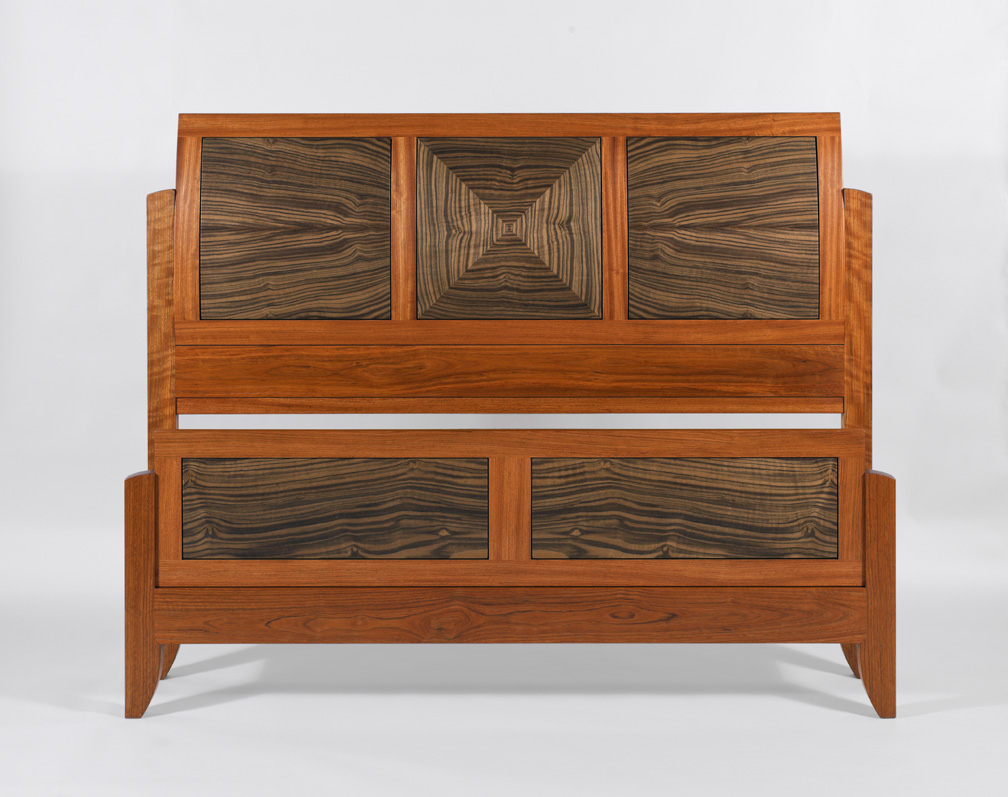 beautifully contrasting wood bed with curved headboard by Hugh Montgomery