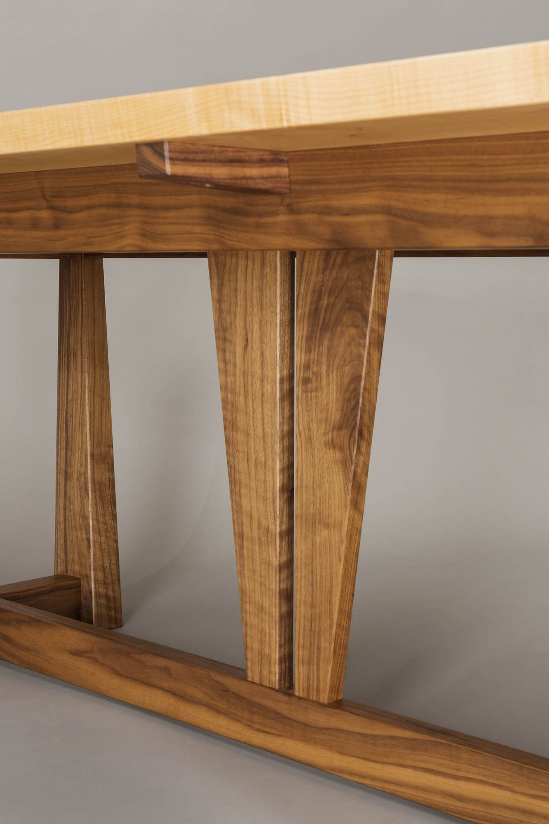 walnut and western maple dining table by Hugh Montgomery