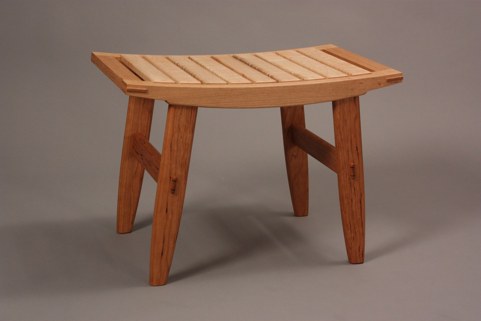 comfortable Cherry wood bench seat with Maple wood slats by Hugh Montgomery